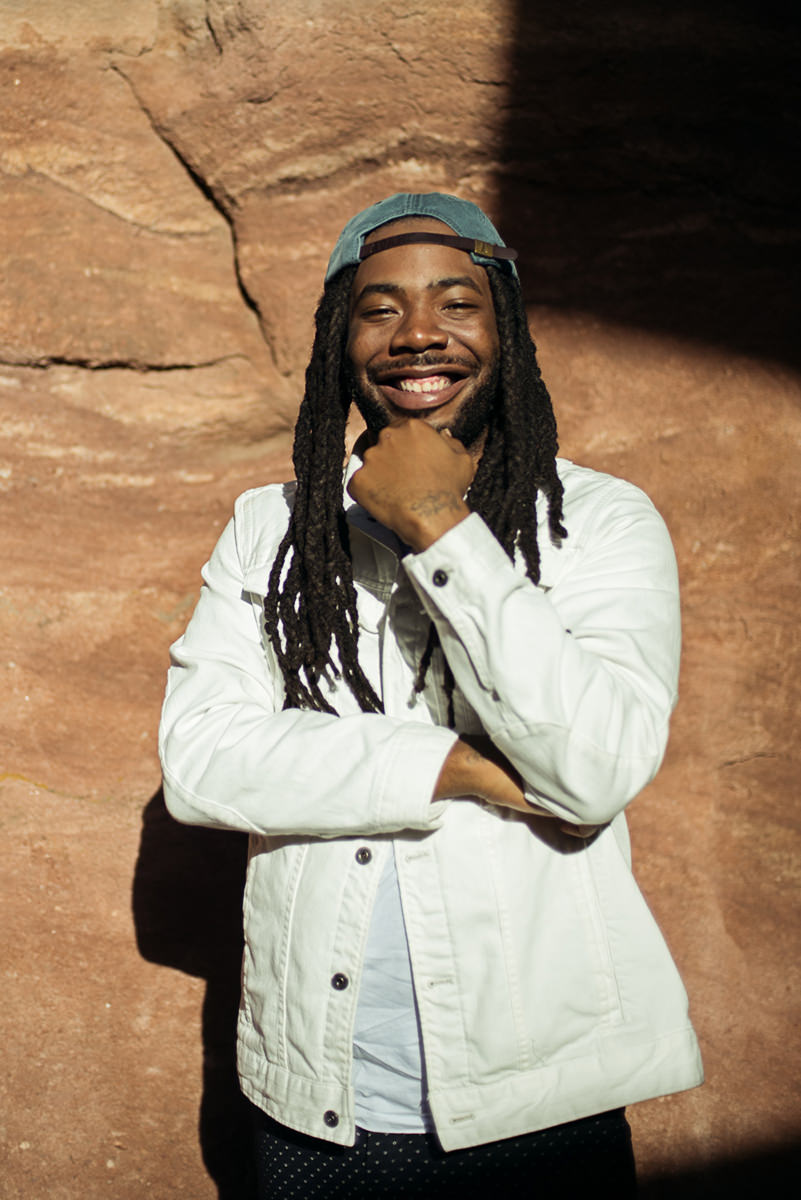 Musician portrait of Rapper and Singer D.R.A.M. posing backstage at the Mad Decent Block Party for a portrait at Red Rocks in Morrison, Colorado.