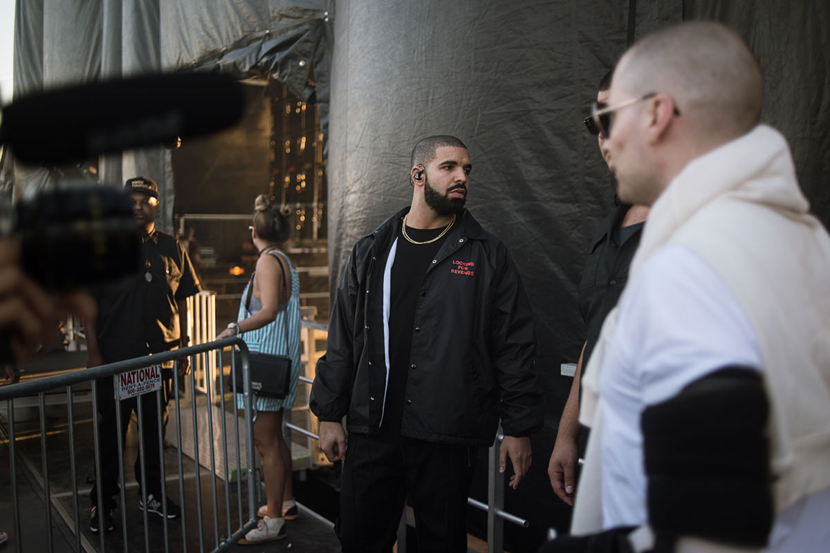 New York City based photographer specializing in live music and portrait photography. Drake moments before his surprise performance at the Mad Decent Block Party at MCU Park in Brooklyn, NY on August 7th, 2016. Photograph by Loren Wohl